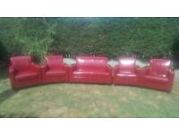 Red leather two seater sofa and 4 armchairs