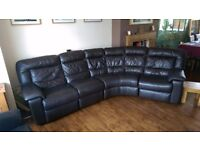 Leather corner curve sofa. Twin recliners and 5 seats