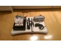 Nintendo Wii Black Console w/ Balance board, controller and charging station