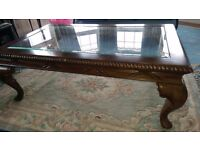Walnut glass top coffee table. Immaculate condition.