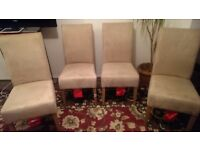 Six high back beige suede chairs for sale