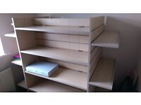 Ex yankee candle display stand. Has been used as a bookcase. Very sturdy with adjustable shelves.