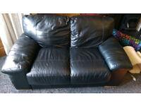Free: 2 seater black leather sofa