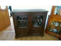 Bookcase dark oak, Stanley wood of Olney damage to one glass panel