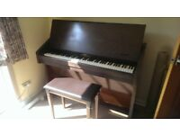 Challen compact piano with roll up top.