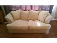 A pair of three seater sofas