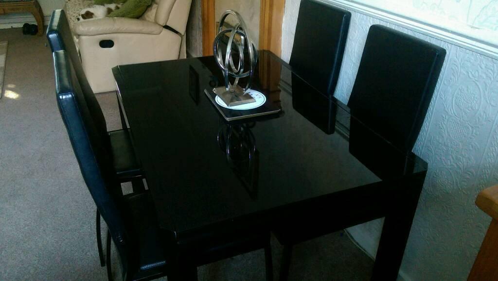 Black glass extendable still for sale