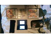 black nintendo ds lite with 5 games and case as good as brand new
