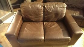 Two brown leather settees