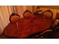 Dinning room table, four chairs, two carvers. Excellent condition. Upholstry perfect.