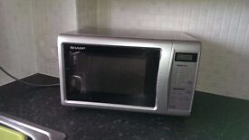 Sharp Microwave Oven in Good Condition with Cook and Defrost Settings
