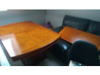 Solid wood extendable dining table and 6 matching chairs