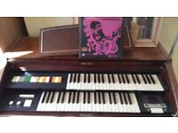 Original Hammond Organ with full original book of songs and lessons.
