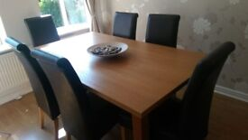 Light oak dining table and 6 leather chairs