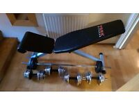 Workout bench, barbell and dumbells for sale. Used but good condition. Price negotiable