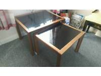 Pair of wood and glass tables
