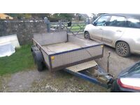 Twin axle(with brakes) steel frame trailer with checker plate sides and base