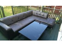 Black leather corner couch and table
