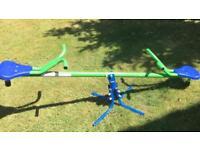 Children's rotating seesaw