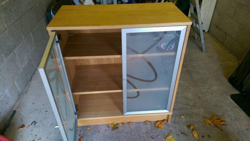 Solid glass door cabinet