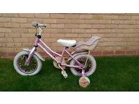 Girls bike with detachable stabilisers - £5