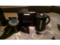 Black kettle, bread bin and biscuit tin