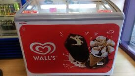 Walls display ice cream freezer. Round table cast iron & laminate top