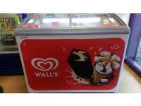 Walls display ice cream freezer. Round table cast iron & laminate top