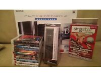 80GB PS3 in piano black with games and extras