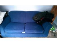 Blue double spring pull out sofa bed. Immaculate condition. All washed and clean