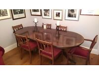 6-8 seater extendable dining table and 6 chairs