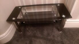 Black glass table with chrome legs