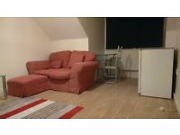 small double bedroom with own living room in chessington