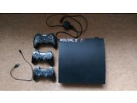 Sony PS3 slim 120gb Console and 26 Game Bundle and 3 controllers