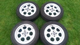 4 x mini 15 inch alloy wheels and tyres. 3 in fair condition an 1 has a dint but is useable.