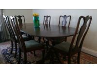 Mahogany oval table, extendable, length 210cm, width 99cm, height 75cm, and six chairs.