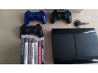 Playstation 3 500GB with 3 remotes, 7 games and headset