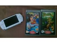 SONY PSP 3000 with 2 boxed games.