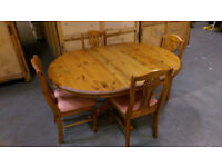 Solid wood extending dining table and 4 matching chairs in immaculate condition.