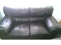 Double seater black leather sofa