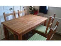 Solid oak dining table plus 4 wooden chairs with seat pads