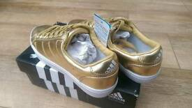 Adidas superstar trainers gold new