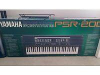 Yamaha Portatone PSR-200. With stand.