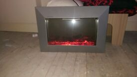Wall mounted electric log effect fire.