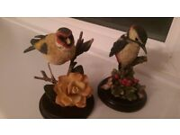 Ornamental birds on wooden stands