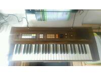 Casio keyboard. Wooden vintage, beginners/advanced with music sheet holder