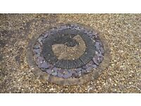 Quality garden stone, decorative stone pebble fish design. With/without surrounding stone course.
