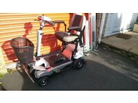 Quingo Flyte Mobility scooter with ramp, VGC, only 47 hours run, charger and accessories inc baskets