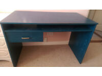 Blue wood-effect desk with shelf and drawer