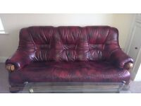 Sofa red leather 3 seater with wooden detail in good condition